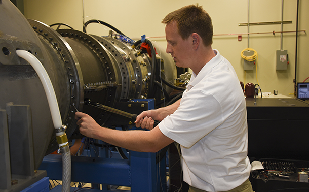 Graduate Student Ken Clark works in the START lab.