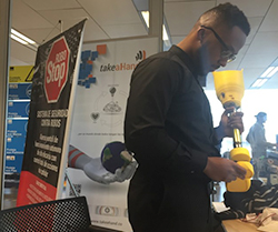 Robinson Laventure inspects TakeaHand's 3D-printed prosthetic leg